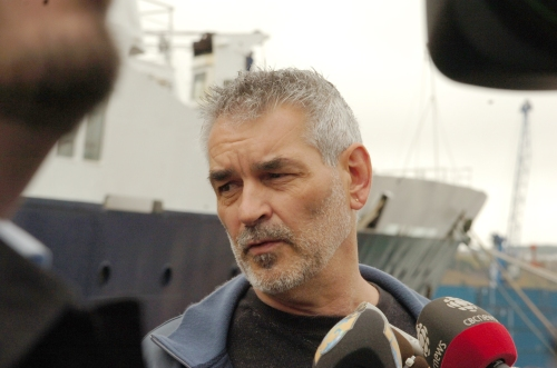Gerard Bradbury of the International Transport Workers Federation speaks with reporters Friday on the dock in St. John's next to the stranded Russian cruise ship Lyubov Orlova. The ship and its crew remain in the capital city while the fate of the vessel is decided by its owners.Ñ Photo by Gary Hebbard/The Telegram